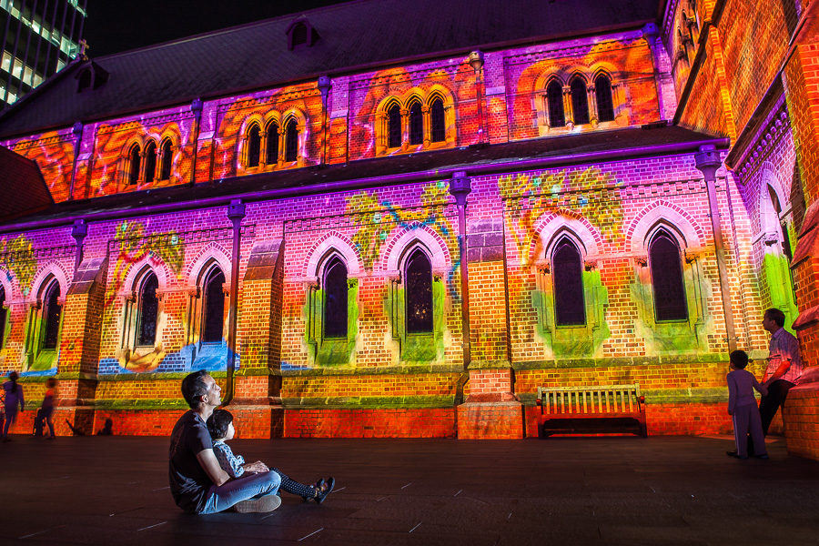 A boy and his dad enjoy the Christmas projections as part of the City at Christmas