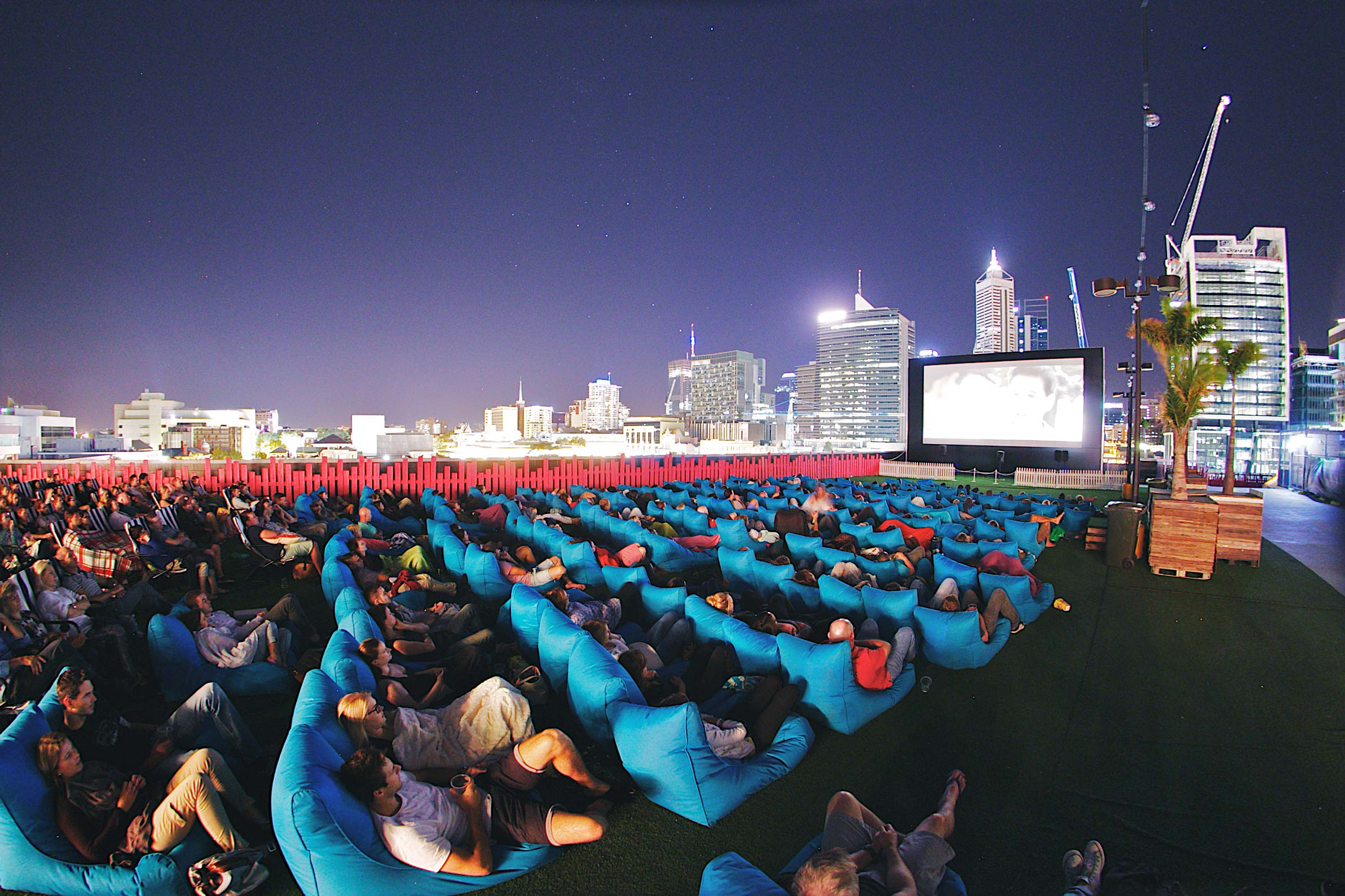 Rooftop movie theatre with the city in the background